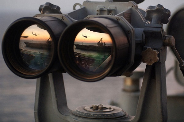 Larger apertures are good, but require mounting as shown in this photo of navy binoculars by Airman Ricardo J. Reyes.
