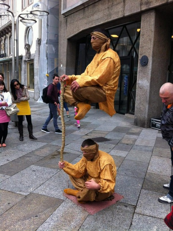 2 person levitation act street performer