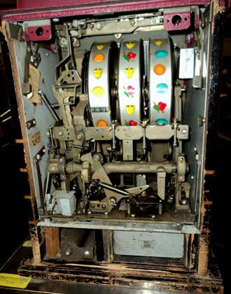 Inside an antique mechanical slot machine.