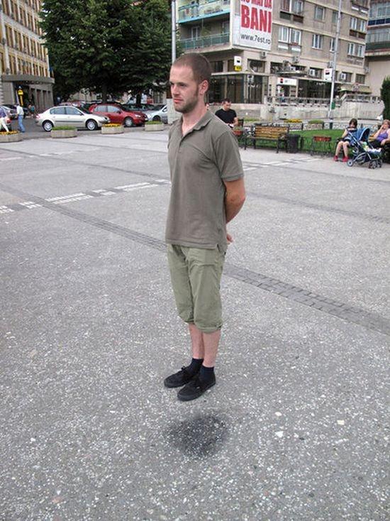 Man levitating on the street
