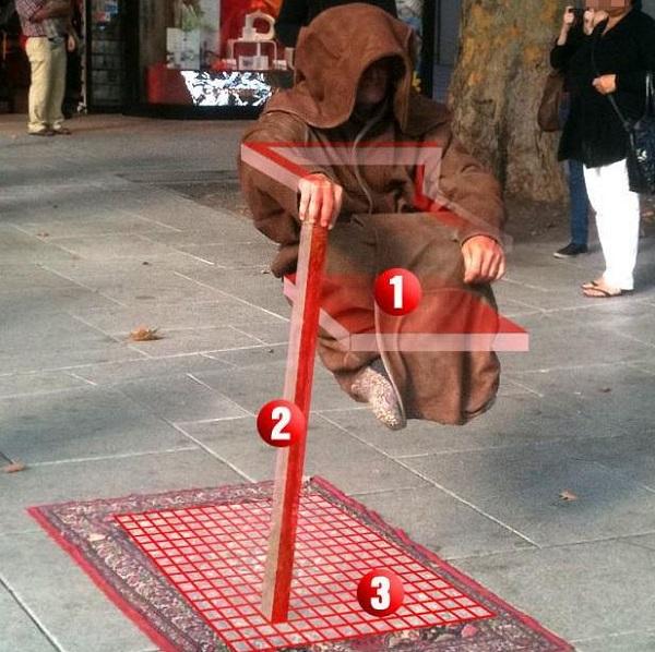 levitating street performer magic trick revealed