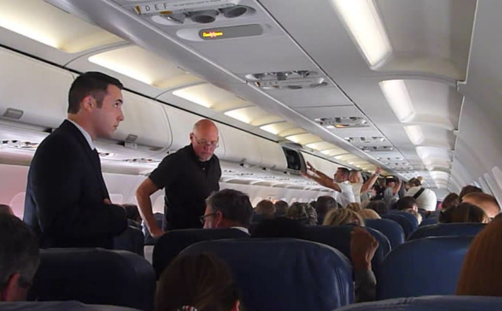 a man switches seats on a flight