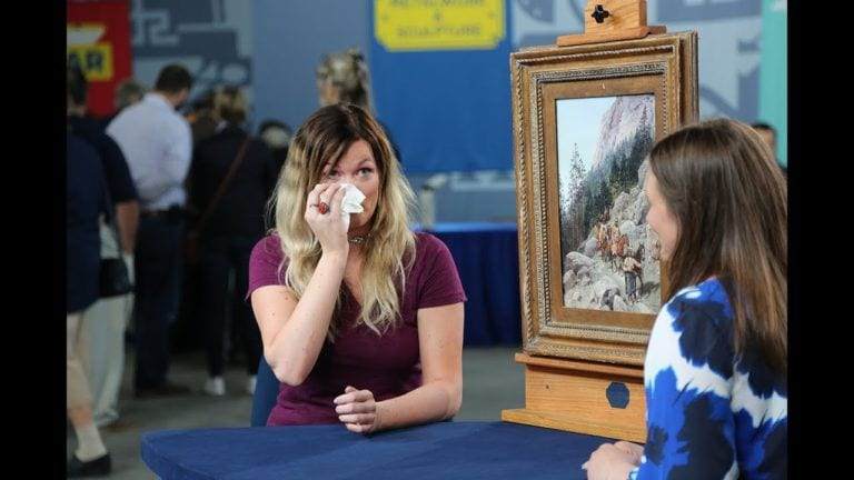 woman cries about grandma painting