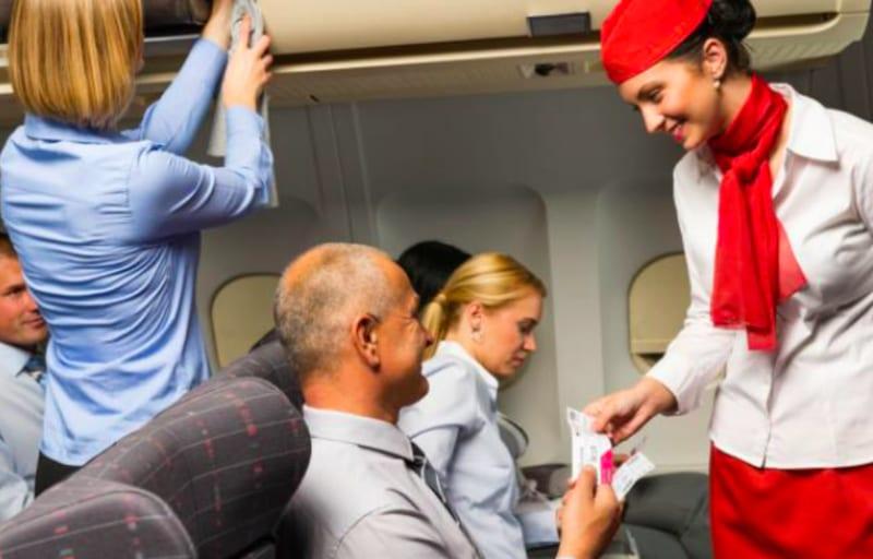 flight attendant attends to passengers