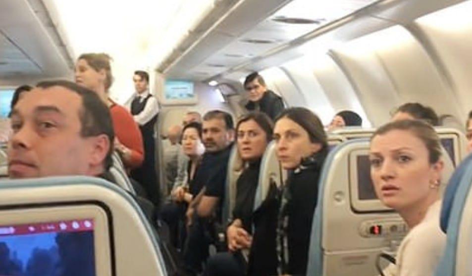passengers gossip on flight