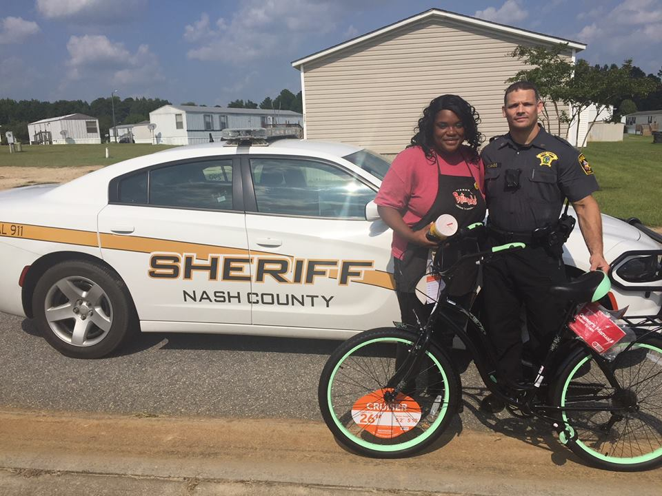 Scott Bass gives woman bike to drive to work