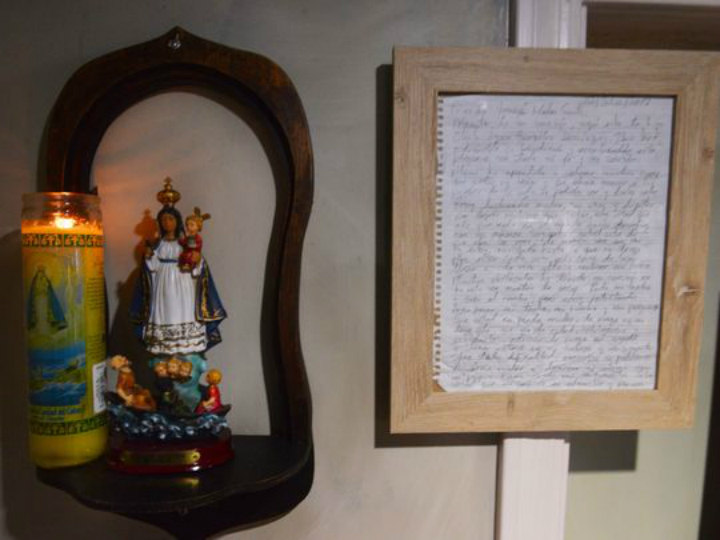 message in bottle framed in shrine