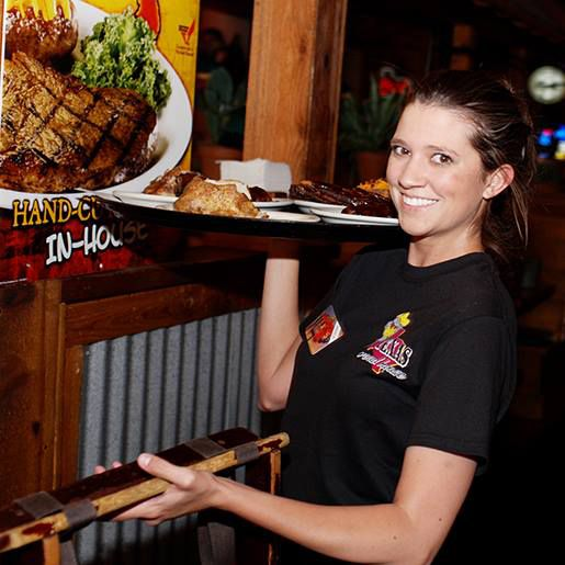 waitress serving tables at Texas Roadhouse