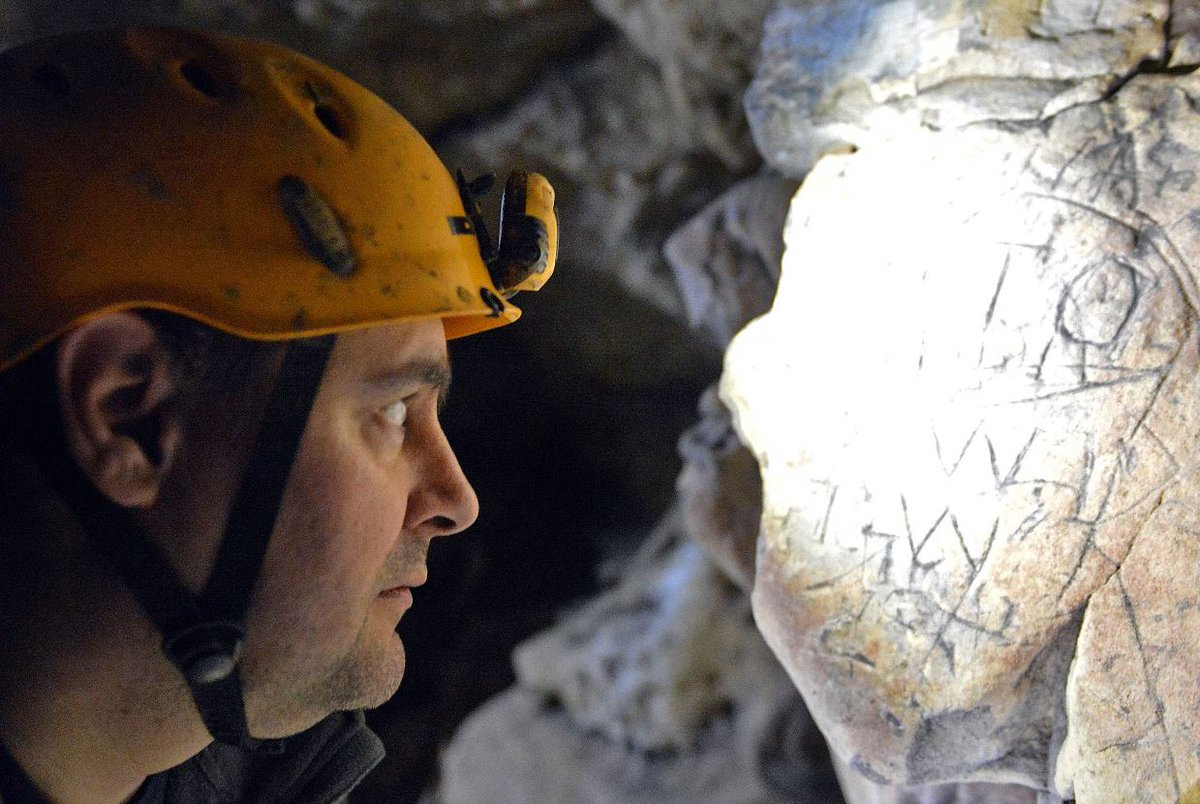 Ed Waters studies the cave walls