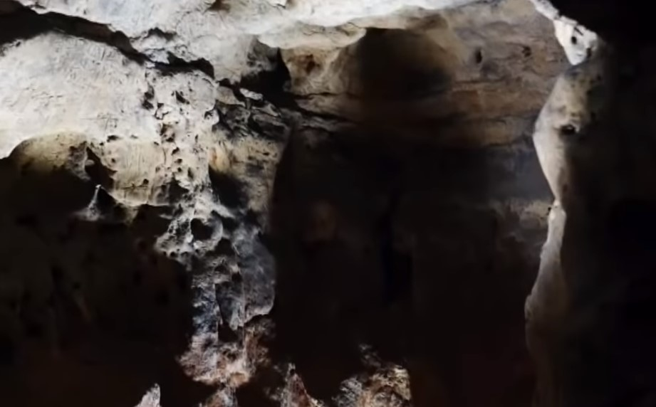 a deep hole inside the cave