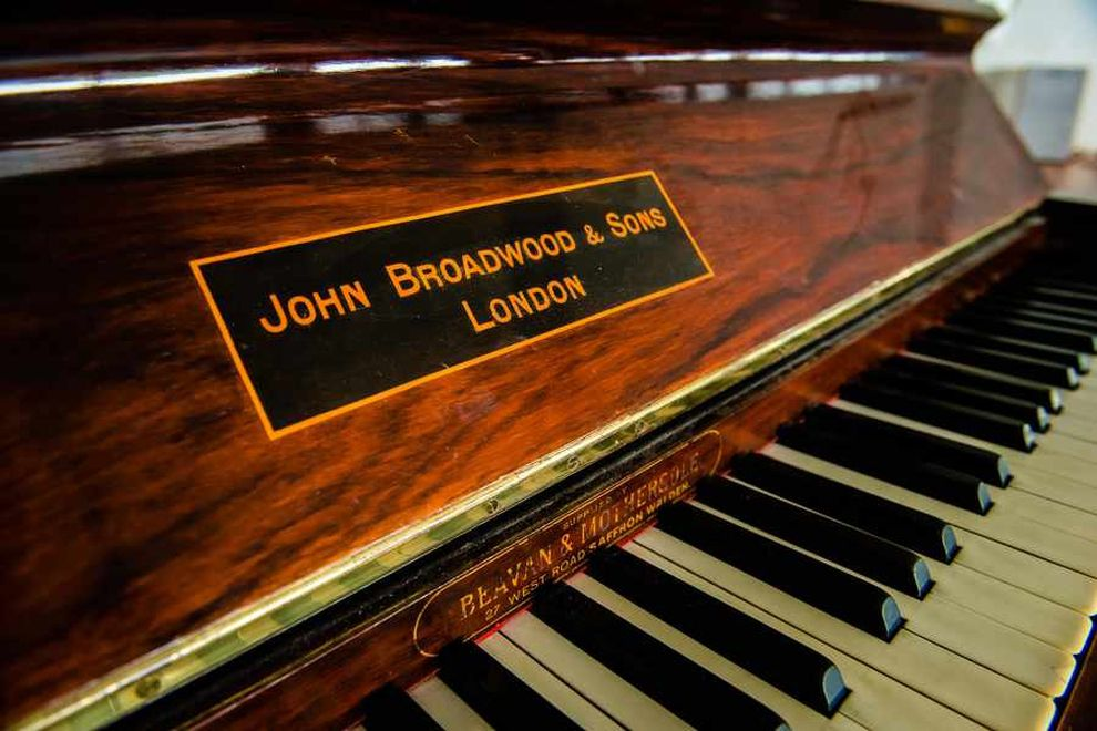beautiful antique piano restored to its former glory