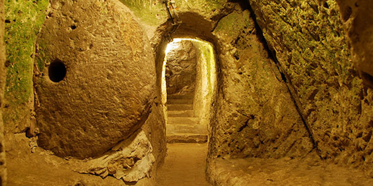 a carved tunnel within the underground cave