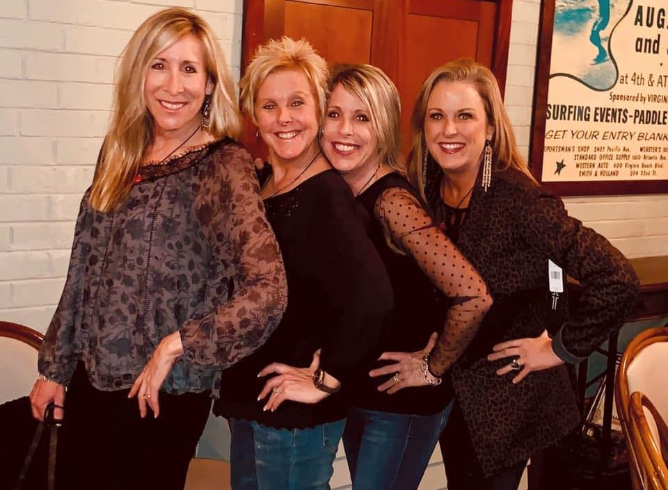 the four sisters pose together